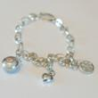 http://www.sweetbling.com/Peace_Love_and_Cupcakes_Charm_Bracelet_p/plc-2.htm